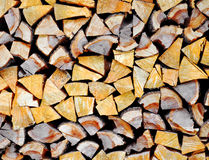 Stacked firewood background Royalty Free Stock Photos