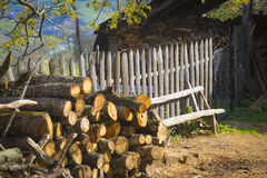 Stacked firewood at a countryside house yard Stock Photos
