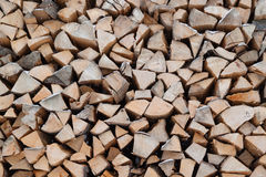 Stacked firewood. Dry chopped firewood logs ready for winter royalty free stock photography