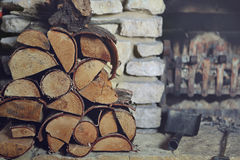 Stacked firewood on hearth Stock Photo