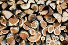 Stacked firewood logs, abstract background Royalty Free Stock Photo
