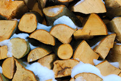 Stacked firewood in winter under the snow Royalty Free Stock Photo