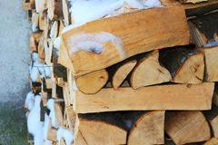 Stacked firewood in winter under the snow Royalty Free Stock Image
