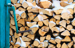 Stacked firewood in winter under the snow Stock Photos