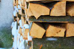 Stacked firewood in winter under the snow Stock Photography