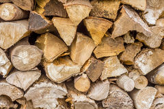 Stacked firewood of a wood pile Royalty Free Stock Photo