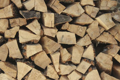 Stacked firewood in woodpile Stock Images