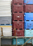Stacked Fish Packing Crates on a Dock Stock Images
