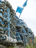 Stacked fishing nets. With blue flags Stock Photography