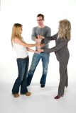 Stacked Fists. Three person business team with fists interlocked in a stack Stock Photography
