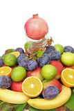 Stacked fresh fruits with pomegranate on the top, Stock Photo
