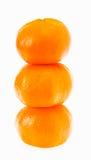 Stacked fresh mandarin isolated white background. Royalty Free Stock Photos