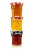 Stacked glass jars with assorted  jam Stock Photo