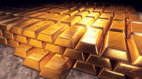 Stacked gold bars or bullion with reflections. Stacked gold bars or gold bullion´s of fine gold 999,9, a thousand gram, one kilogram, with reflections and dark Stock Images