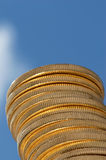 Stacked gold coins. Tower of gold coins, reaching skyward Royalty Free Stock Images