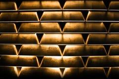 Stacked goldbars. Many stacked goldbars - side view Royalty Free Stock Photography
