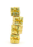 Stacked golden gift boxes Royalty Free Stock Photos