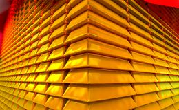 Stacked golden reflective and shiny gold bars or gold bullion stock photography