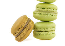 Stacked green and brown cake macaron  on white background, maccarone sweet dessert Stock Photography
