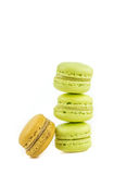 Stacked green cake macaron isolated near one brown macaron on white background, maccarone sweet dessert Stock Images
