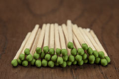 Stacked green tipped matches. Royalty Free Stock Photography
