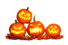 Stacked Halloween Jack o Lanterns isolated on white Stock Photos