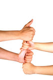 Stacked hands. On top of each other connected by thumbs Stock Images