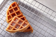 Stacked homemade waffles on sieve Stock Image