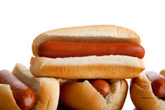 Stacked hot dogs and buns on white Stock Images