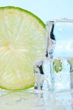 Stacked Ice Cubes And Lime Royalty Free Stock Photography