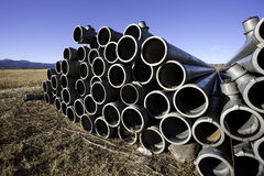 Stacked irrigation pipes. Royalty Free Stock Photos
