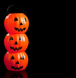 Stacked jack-o-lanterns on black Stock Photography