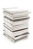 Stacked Jewel Cases. Stacked CDs isolated on a white background stock image