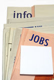Stacked jobs newspapers Royalty Free Stock Images