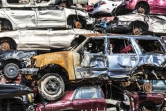 Indianapolis - Circa September 2017: Stacked junk yard clunker cars prepared for crushing to be recycled XI. Stacked junk yard clunker cars prepared for crushing Royalty Free Stock Photography