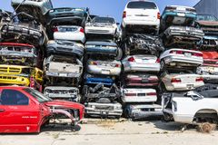 Indianapolis - Circa September 2017: Stacked junk yard clunker cars prepared for crushing to be recycled XIII. Stacked junk yard clunker cars prepared for Royalty Free Stock Photo
