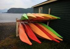 Stacked Kayaks in the Rain Stock Images