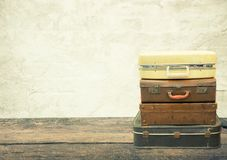 Stacked leather luggage on wood plank with old concrete backgrou. Nd. Travel concept Stock Images