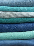 Stacked light blue bath towels Royalty Free Stock Photos