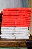 Stacked linens red and white on a table Royalty Free Stock Image