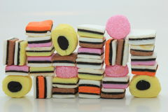 Stacked liquorice allsorts. In different shapes, colors and sizes Stock Photo