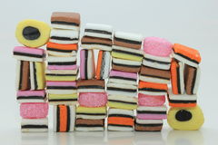 Stacked liquorice allsorts. In different shapes, colors and sizes Royalty Free Stock Photo