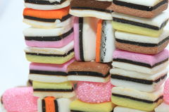 Stacked liquorice allsorts. In different shapes, colors and sizes Stock Images