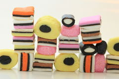 Stacked liquorice allsorts. In different shapes, colors and sizes Stock Image