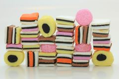 Stacked liquorice allsorts. In different shapes, colors and sizes Stock Photography
