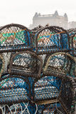 Stacked lobster pots in the harbour. Scarborough Grand Hote Stock Photos