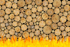 Stacked Logs Background in fire Royalty Free Stock Images