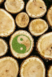 Stacked Logs Background with ying yang symbol Royalty Free Stock Photography