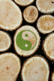 Stacked Logs Background with ying yang symbol Stock Images