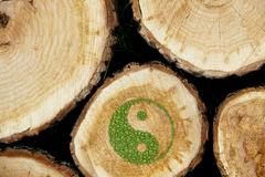 Stacked Logs Background with ying yang symbol Royalty Free Stock Photos